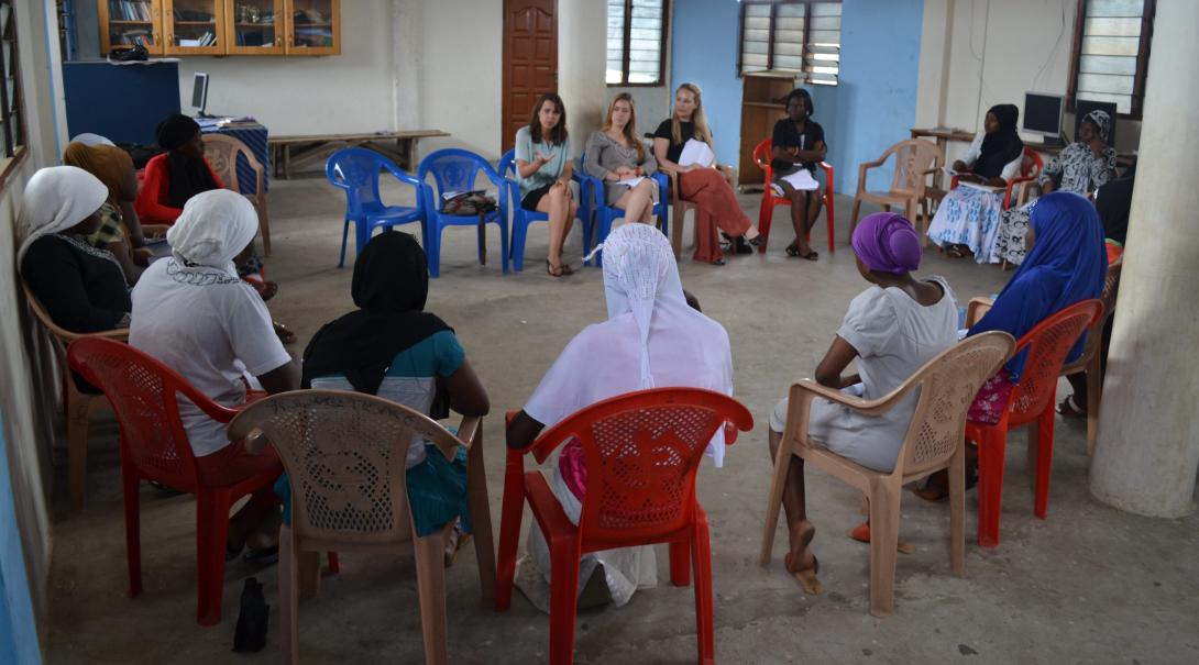 A group of law volunteer discuss legal issues with women in Ghana during their internship with Projects Abroad.